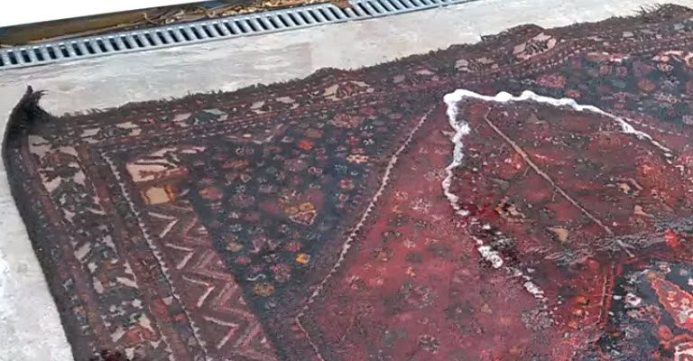 Flooded Persian Rug with Water Damage