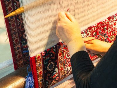 Silk Oriental rug weaving